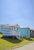 Beach huts on the sea shore. Royalty Free Stock Images