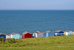 Beach huts on the sea shore. Stock Photography