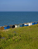 Beach huts on the sea shore. Royalty Free Stock Image