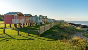Beach huts with sea view royalty free stock photos