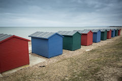 Beach huts at seaside Stock Images