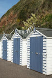 Beach Huts at Seaton, Devon, UK. A set of three blue and white beach huts at Seaton, Devon, UK Stock Photography