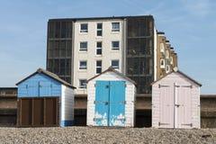 Beach Huts at Seaton, Devon, UK. A set of three painted beach huts at Seaton, Devon, UK Stock Image