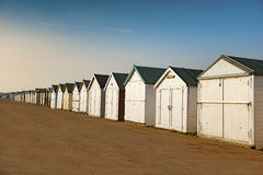Beach huts in Shoeburyness taken during golden hour. Beach huts in Shoeburyness, Essex. Photograph taken during the golden hour. The huts are closed and locked royalty free stock images