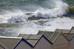 Beach huts and stormy sea Royalty Free Stock Photo