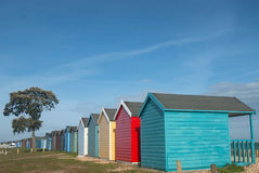 Beach huts on a sunny day. A row of colourful beach huts on a sunny day Stock Images