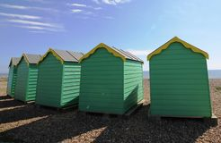 Beach huts on a sunny day stock images