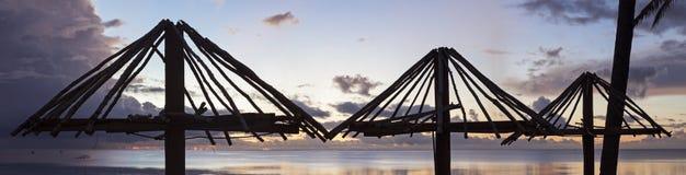 Beach huts at sunset Stock Photo