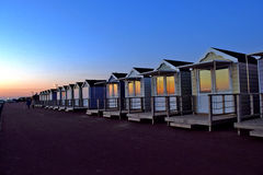 Beach huts after sunset royalty free stock images
