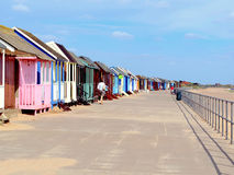 Beach huts, Sutton-on-sea, promenade. A line of colorful beach huts down the side of the promenade at Sandilands, Sutton-on-sea, Mablethorpe, Lincolnshire Stock Image