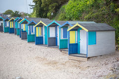 Beach huts on swanpool beach in cornwall england uk Royalty Free Stock Photo