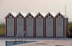 Beach huts and swimming pool Stock Photography