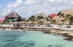 Beach Huts and Tourists at Cozumel Beach Mexico Royalty Free Stock Images