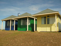 Beach Huts. A trio of brightly coloured beach huts at a typical English seaside resort Royalty Free Stock Image