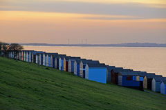Beach huts at twilight. Photo of beach huts along kent coast of whitstable during twilight time march 2017 Royalty Free Stock Photo
