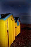 Yellow Beach huts in the evening winter moonlight royalty free stock photos