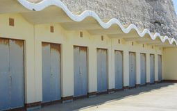 Beach huts under cliff near Brighton. Sussex. England Royalty Free Stock Photo