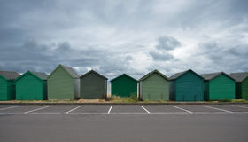 Beach huts under clouds Stock Photo