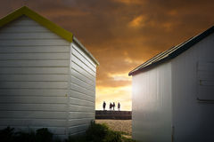 Beach huts and walkers Stock Image
