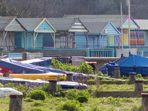 Beach huts, Whitstable. Colourful huts and dinghies in Whitstable Royalty Free Stock Photo
