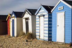 Beach huts in winter. A row of beach huts at South Beach, Southwold. February 2008 stock images