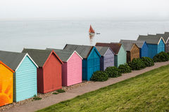 Beach Huts and a yacht Royalty Free Stock Images