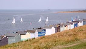 Beach huts and yachts Stock Images