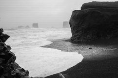 The beach in Iceland. Iceland, Rocky beach in the strong storm Royalty Free Stock Photos