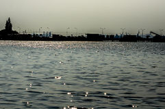 Beach at industrial location. The viewpoint from sea where industrial location is behind Stock Images