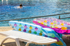 Beach inflatable mattress on the edge of the pools. Stock Photo