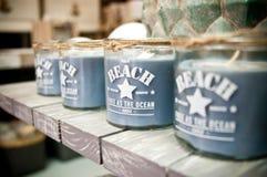 Beach inscription aroma candles stock photos