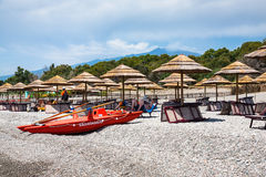 Beach on Ionian Sea coast and view of Etna mount. FLUMEFREDDO DI SICILIA, ITALY - JULY 5, 2011: people on beach spiaggia di Marina di Cottone on Ionian Sea coast Stock Image