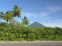 Beach on Isla Ometepe, Nicaragua. Beautiful black sand beach on the isla de emetepe with volcano Concepcion in the background Royalty Free Stock Photography