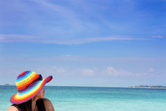Beach and island. Portrait of woman vacation at beach with island at background Royalty Free Stock Images