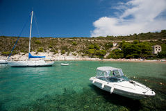 The beach on the island of Bisevo, Croatia. The beach on the island of Bisevo, with swimmers, yacht and luxury boat Stock Image