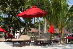 Beach in island Koh Chang ,Thailand. Beach umbrella and deck chairs on the beach. Island Koh Chang, Thailand stock photos