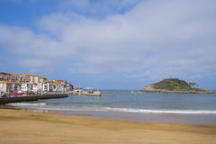 Beach and island in Lekeitio village. Royalty Free Stock Photography
