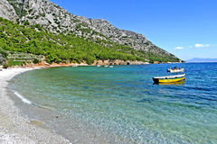 A beach on the island of samos greece. Samos greece island in its blue and warm waters rushing white and clean gravel and sand beach Stock Photos