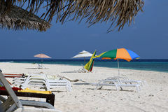 Beach of the island Ukulhas - perfect for relaxing with sunshade and sun lounger at the Maldives Stock Image