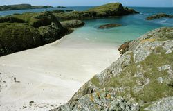 Beach on Isle of Iona. Landscape shot of a beach on the holy isle of Iona in the inner hebredies in scotland stock photo