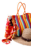 Beach items. Colorful striped bag, bright kerchief, sunglasses and straw hat stock images