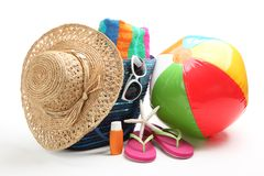 Beach items. With straw hat,towel,flip flops,sunblock,beach ball and sunglasses Royalty Free Stock Photo