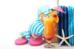 Beach items. With swimming suit,towel,flip flops and a glass of cocktail.Isolated on white background Stock Images