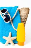 Beach Items. With towel and basket with sunglasses and suntan lotion on white background Stock Image