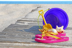 Beach items on boardwalk Royalty Free Stock Images