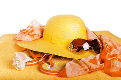 Beach items a hat, a towel and slippers, it is isolated on white Stock Photography