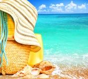 Beach items over blue sea Royalty Free Stock Photos
