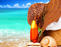 Beach items over blue sea Stock Image