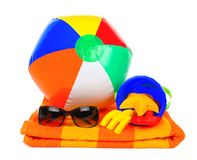 Beach items over white. Colorful beach items on a towel over a white background stock photography
