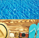 Beach items at pool. Travel and beach items at pool Royalty Free Stock Photography